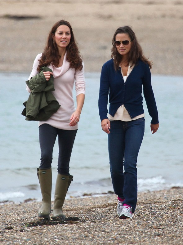 Kate and Pippa Middleton take a stroll on the beach in Llanddwyn, North Wales