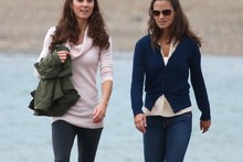 Sisterly stroll: Kate and Pippa go for a walk on the beach in Wales