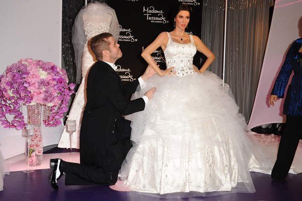 Kim Kardashian waxwork in bridal gown unveiled by Perez Hilton at Madame Tussauds.