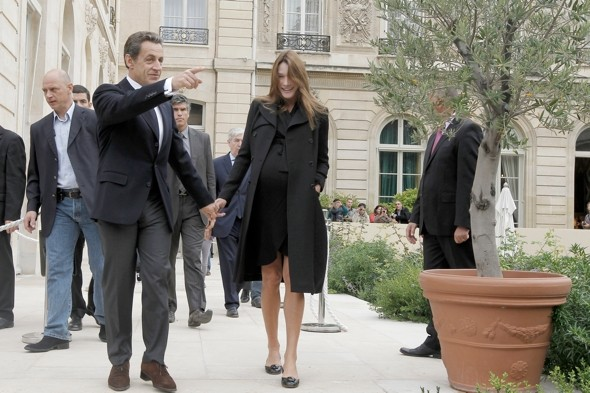 Carla Bruni shows off BIG baby bump in Paris