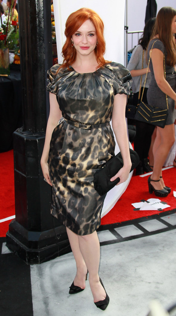 Christina Hendricks shows off her hourglass curves in leopard print dress