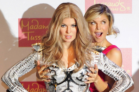Two Peas in a pod? Fergie unveils long-haired waxwork as she debuts short hair