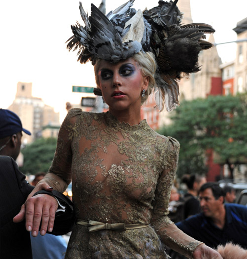 Lady Gaga in a pigeon wing hat