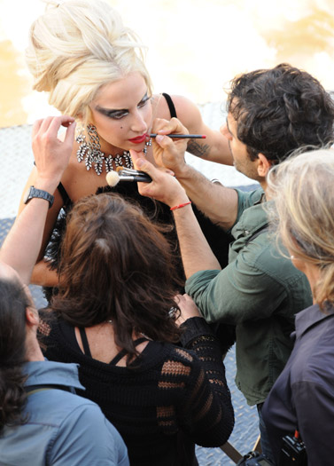 Lady Gaga gets her makeup retouched