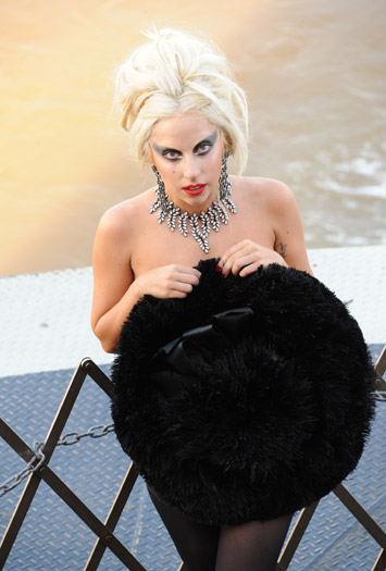 Lady Gaga in jewels, a hat and not much else