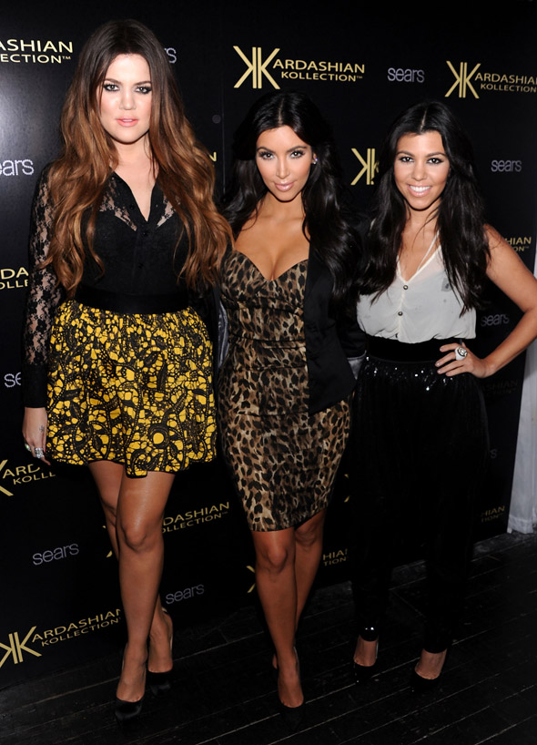 Assorted Kardashians. They're in leopard print. We have pictures.