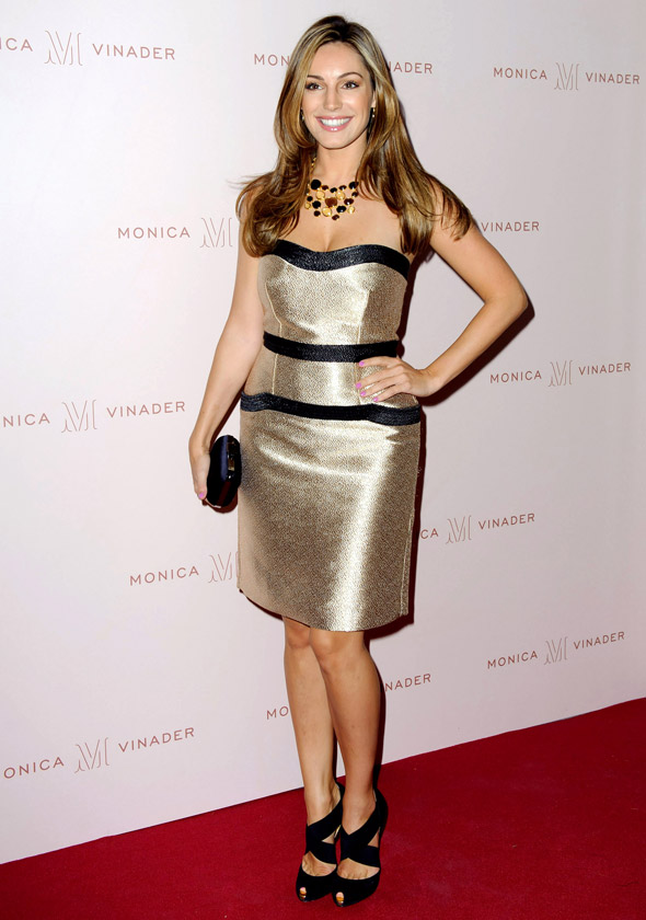 Golden girl: Kelly Brook shines in metallic strapless dress in London