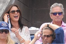 Catherina Zeta Jones and Michael Douglas take in the tennis in style