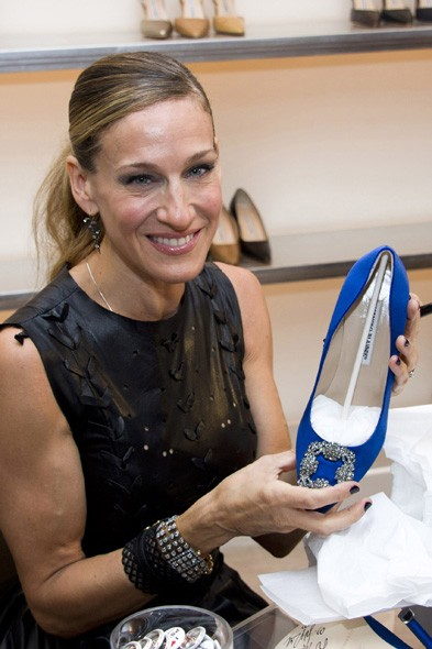 Sarah Jessica Parker signing shoes at Manolo Blahnik