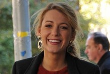 Blake Lively's back on the Gossip Girl set in mini skirt and to-the-knee boots