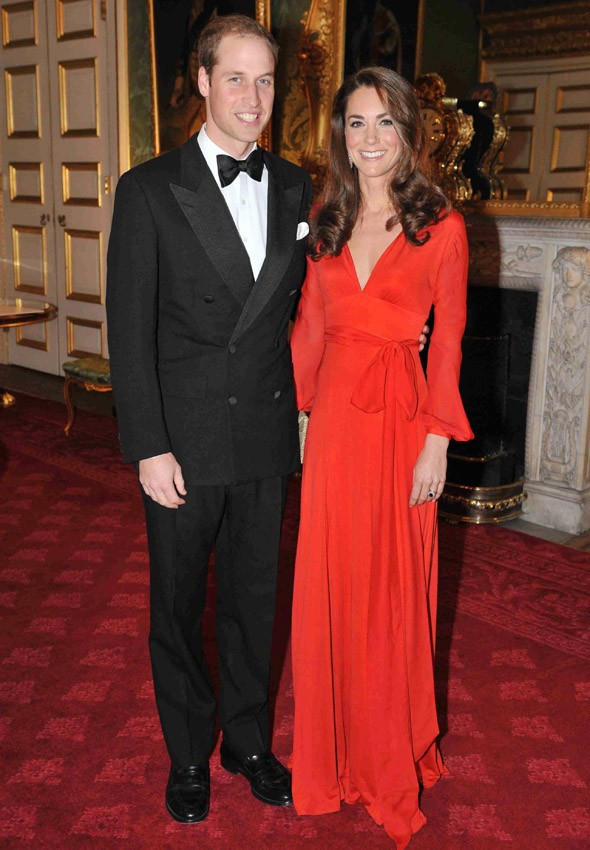 Kate sizzles in red maxi for charity black tie soiree