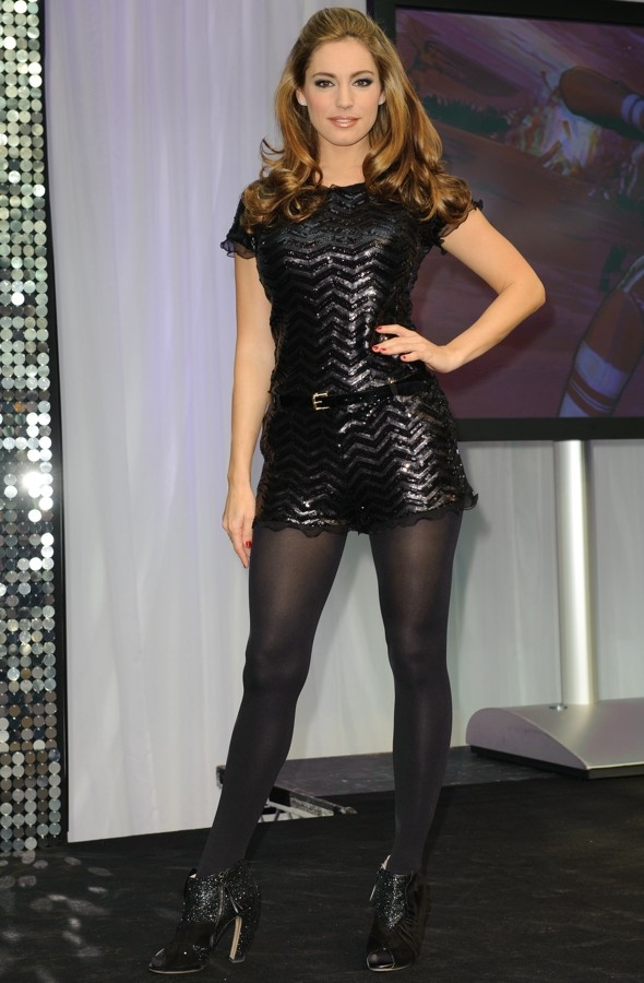 Kelly Brook's curves in disappearing act: model shows off slender frame in black playsuit