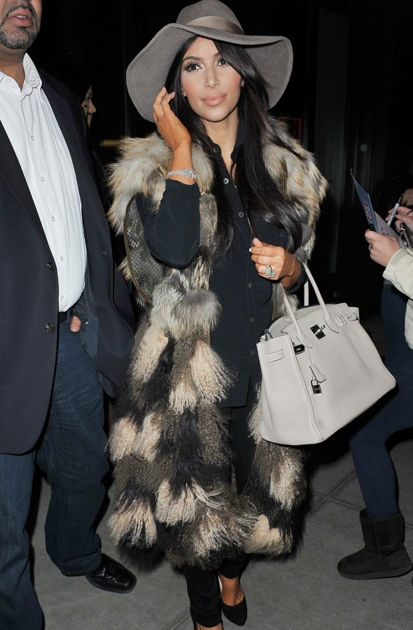 Is it a yeti? No, it's Kim Kardashian in a VERY hairy coat