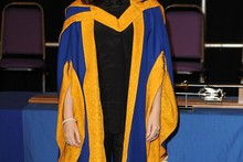 Kylie rocks blue and orange (and brown hair) to receive honorary degree
