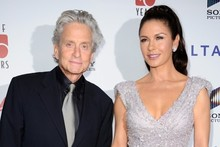 Silver star: Catherine Zeta Jones DAZZLES on red carpet with Michael