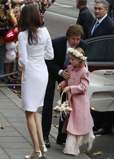 Nancy Shevell arrives at Marylebone Town Hall with a flower girl