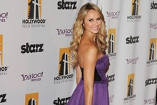 Stacy Keibler's really getting the hang of this red carpet dressing