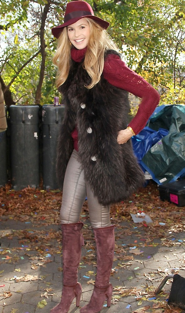 Still super! Elle Macpherson pulls off youthful knee-high boots, fur and fedora ensemble