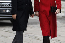 Katie in red: Duchess dons a bright coat for visit to Unicef facility