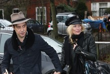 Kate Moss wears US policeman style hat to move into new home