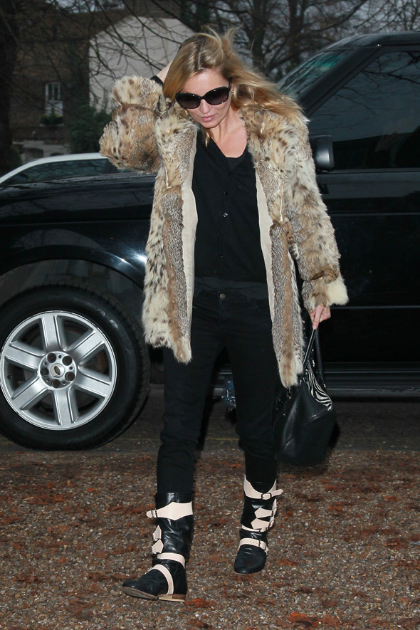 Kate Moss keeps warm in winter-wear but her nude pic is worth £16,250