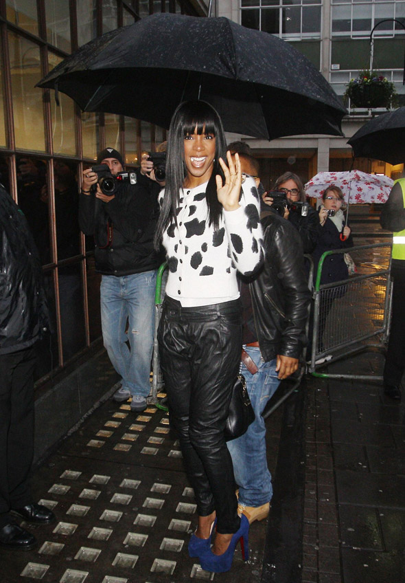 Mixed moo-ssage: Kelly Rowland wears cow-print cardi and leather trousers