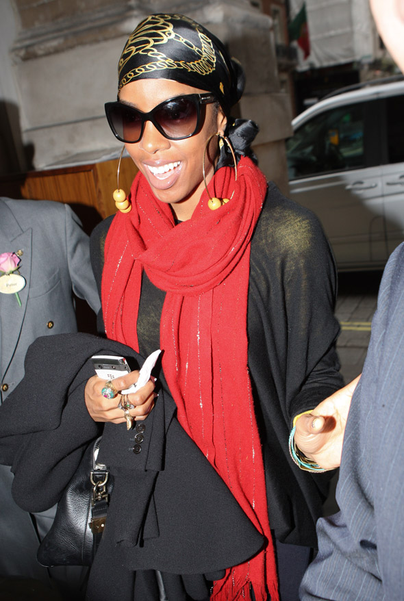She's baaaaack! Kelly Rowland returns to London sporting a double-scarf look
