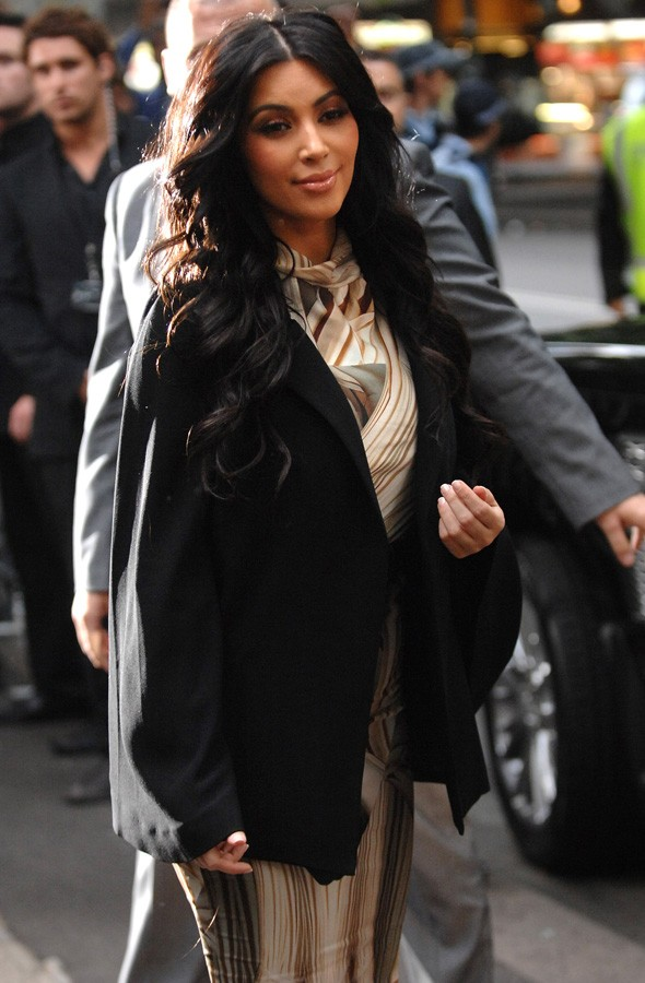 No divorce downtime for Kim Kardashian: she's back to work (but looking sad)