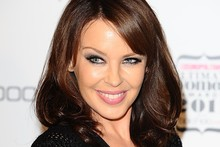Kylie Minogue and her glossy brunette locks hit the red carpet