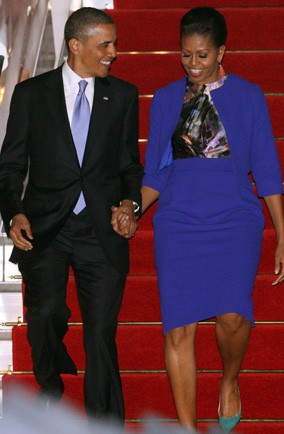 Michelle Obama arriving in London wearing Preen