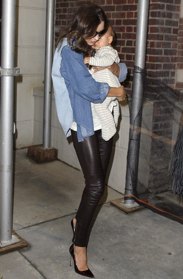 Miranda Kerr rocks leather trousers and killer heels (with baby in tow)