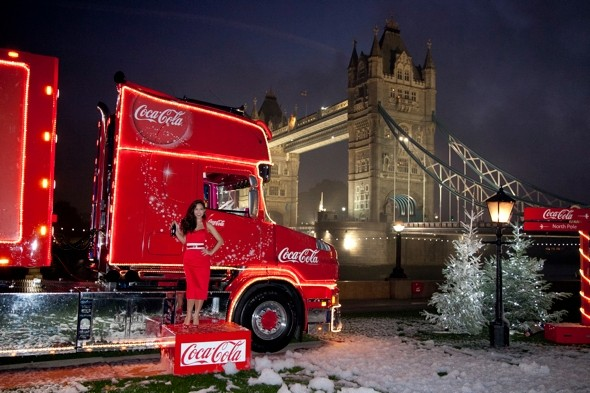 Santa, baby: Myleene Klass is festive-fabulous as she launches Christmas Cola tour
