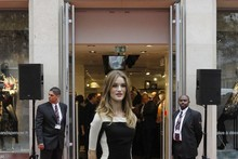 Rosie Huntington-Whiteley wears two M&S dresses at Paris store launch
