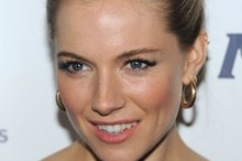 Sienna Miller sports the ultimate updo