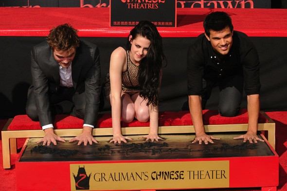 Robert Pattinson, Kristen Stewart and Taylor Lautner at Grauman's Chinese Theatre