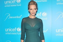 Hot or not: Uma Thurman shows off curves in corseted dress