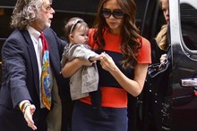 Victoria Beckham hits the shops with Harper in another of her own designs