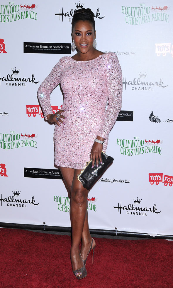 Foxy lady: Vivica A Fox dons glitzy pink minidress for Christmas benefit