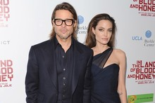 Brad and Angelina get cosy on the red carpet