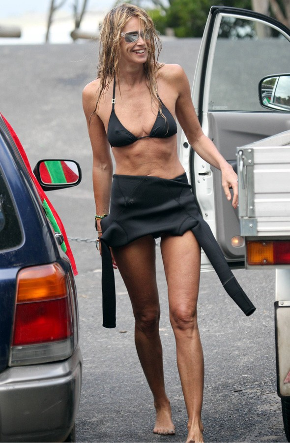 Still got it! Elle Macpherson proves she's still 'The Body' to go surfing in Australia