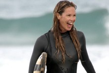 Still got it! Elle Macpherson goes surfing in Australia in skimpy wetsuit