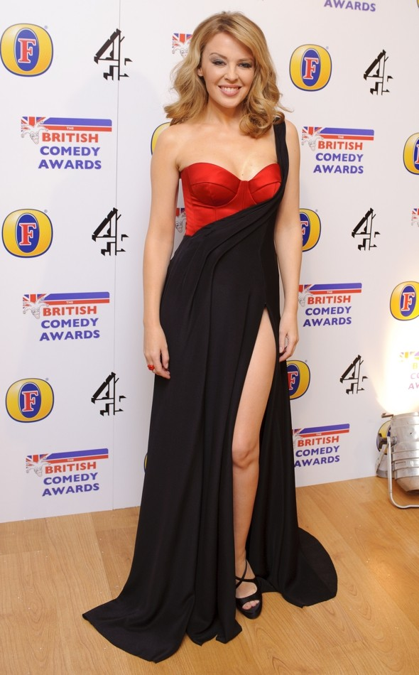 Kylie Minogue steals the British Comedy Awards show in sexy split dress