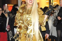 Lady Gaga sports Rapunzel-length hair and a lot of gold for shopping trip in Japan