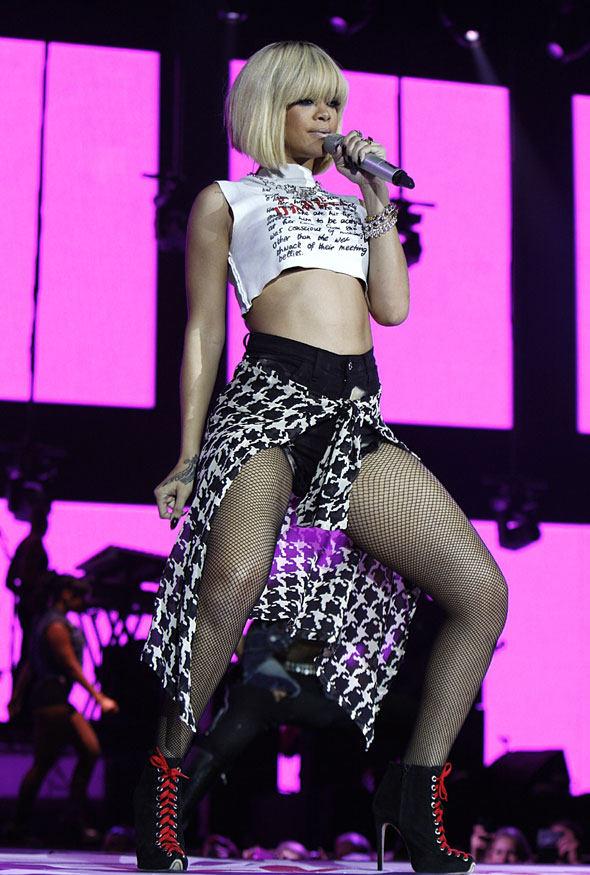 Jingle belle: Rihanna rocks bare midriff and fishnets for latest performance