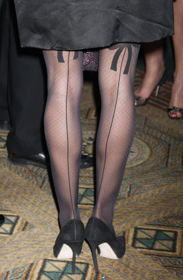 Festive fashion: SJP was rocking some sexy seamed stockings at the charity ...