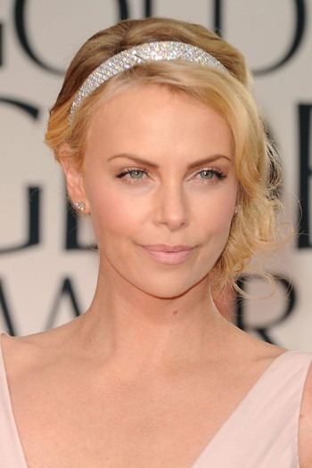 http://www.blogcdn.com/www.mydaily.co.uk/media/2012/01/charlize-theron-1326706791.jpg