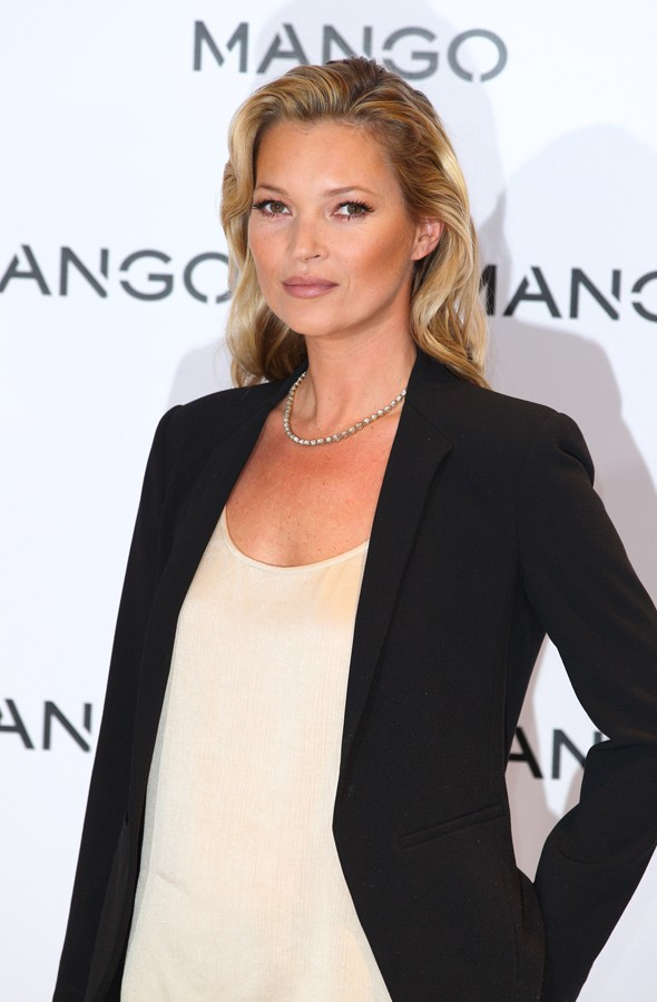 Kate Moss is rocks radiant skin and curled hair at Mango launch