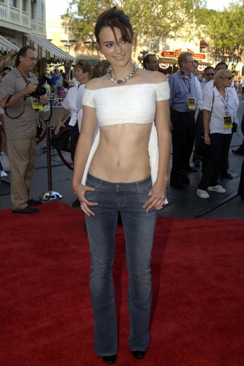 in 2004 and shows off her toned upper body in a plungeneck dress