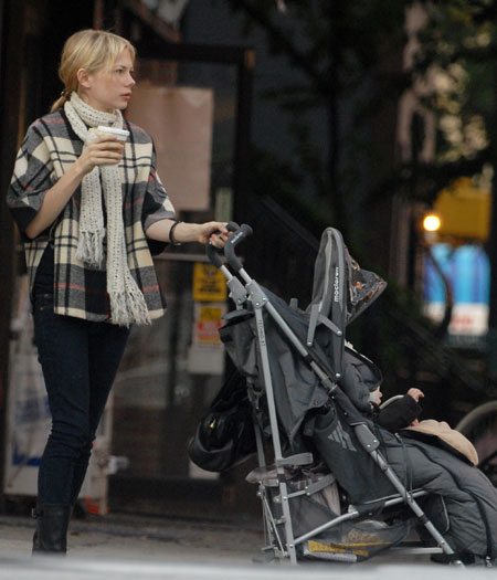 Strolling in Brooklyn with her daughter, Matilda Rose, 2006