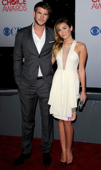 Miley Cyrus in David Koma and Liam Hemsworth